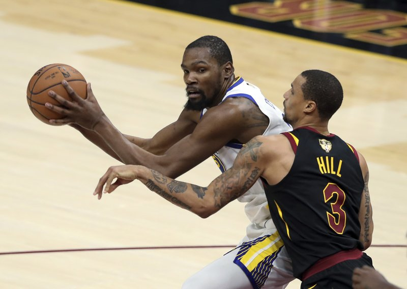 a0b7fcd2c5b7 Golden State Warriors  Kevin Durant is defended by Cleveland Cavaliers   George Hill during the second half of Game 3 of basketball s NBA Finals