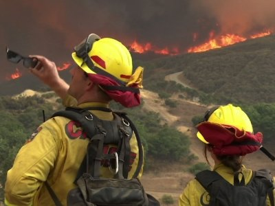 Twin Northern Calif. Fires Threaten 12,000 Homes