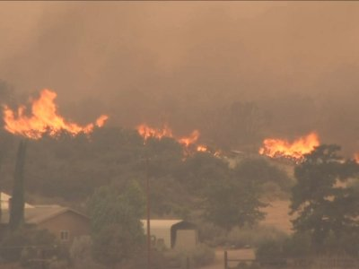 Raw: Firefighters Make Gains at Containing Fire