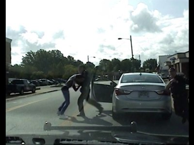 Dash Cam Shows Officer Punching Black Motorist