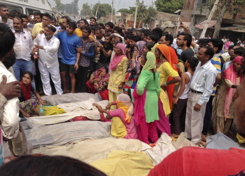 Villagers protest with dead bodies of victims of a boat capsize as they block traffic on the Delhi-Saharanpur highway at Katha village near Baghpat town in Uttar Pradesh state, India, Thursday, Sept.14, 2017. A boat crowded with construction workers capsized in the Yamuna River early Thursday and nineteen bodies have been pulled out of the river so far.