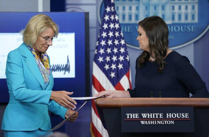 Sarah Huckabee Sanders, Betsy DeVos