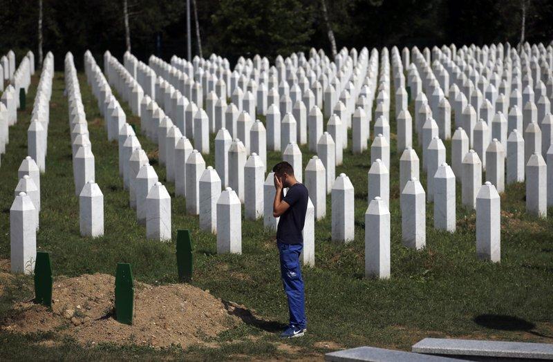 Bosnian Serb leader denies genocide in Srebrenica massacre