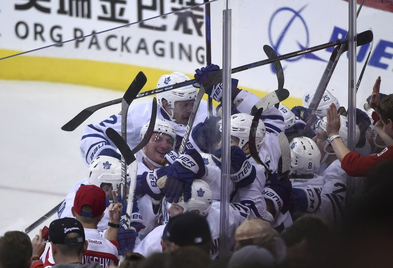 The Toronto Maple Leafs celebrate their 4-3 win against the Washington  Capitals in two overtimes in Game 2 of an NHL Stanley Cup first-round  playoff series ... ccf2aa2bc