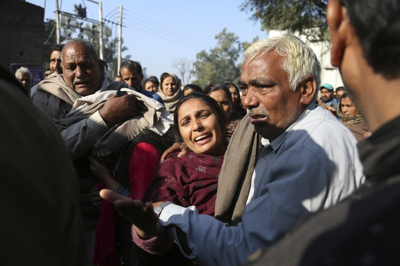 Relatives of Indian boy Sahil kumar who was killed in Pakistani firing and shelling, wail at a hospital in Ranbir Singh Pura district of Jammu and Kashmir, India, Friday, Jan.19,2018. Tensions soared along the volatile frontier between India and Pakistan in the disputed Himalayan region of Kashmir as soldiers of the rivals continued shelling villages and border posts for third day Friday.