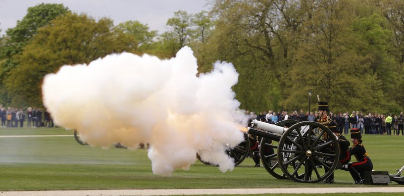 Members of the King's Troop Royal Horse Artillery First World war era fire 13-pounder field guns as part of a 41 gun salute in Hyde Park to mark Britain's Queen Elizabeth II 's 91st birthday, in London, Friday, April 21, 2017.