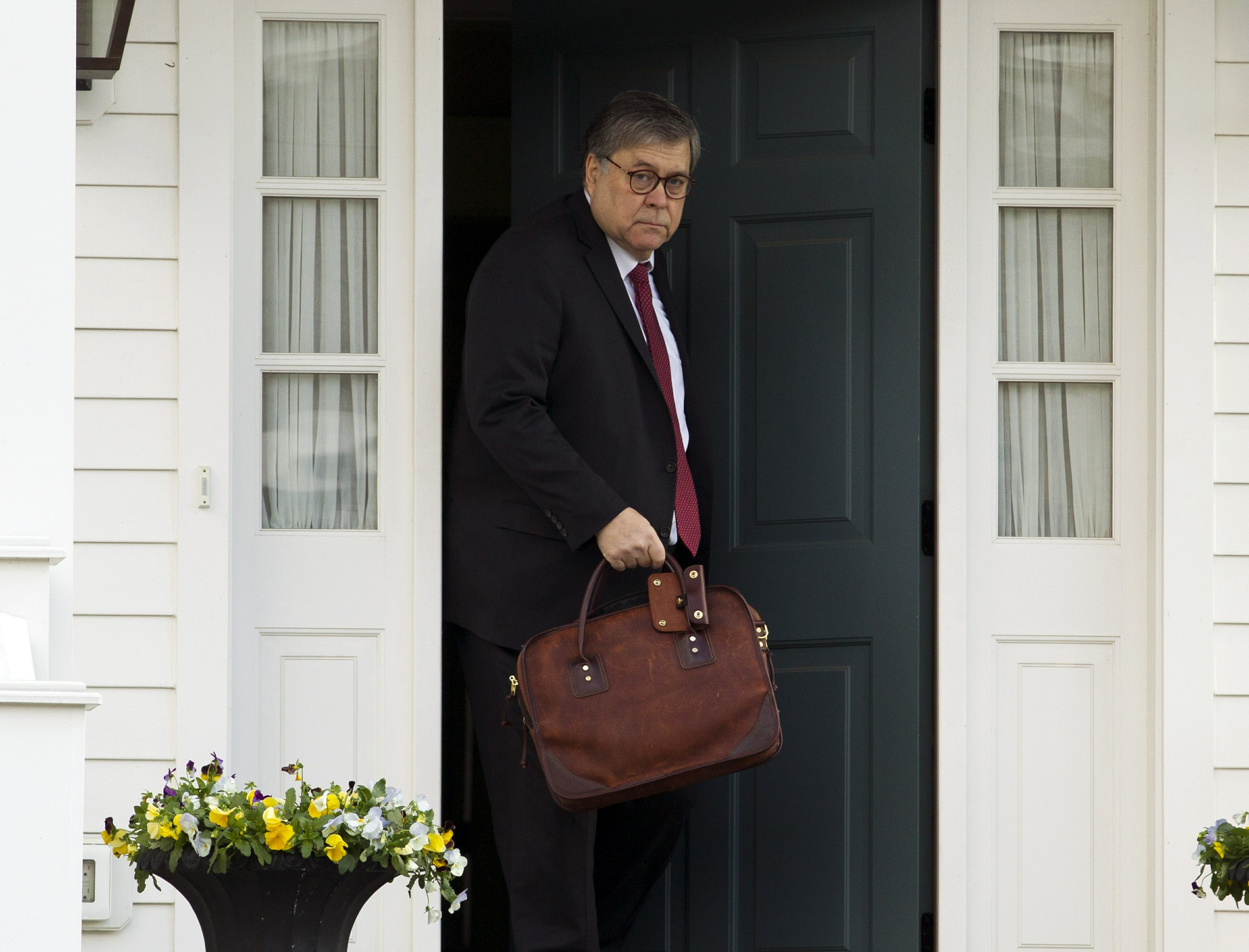 Barr leaving his home