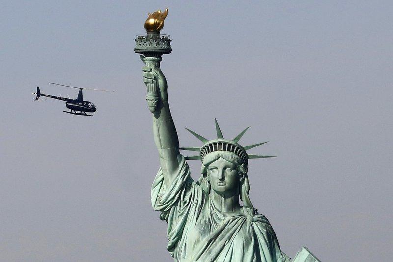 Despite shutdown, troops get football, Lady Liberty to open