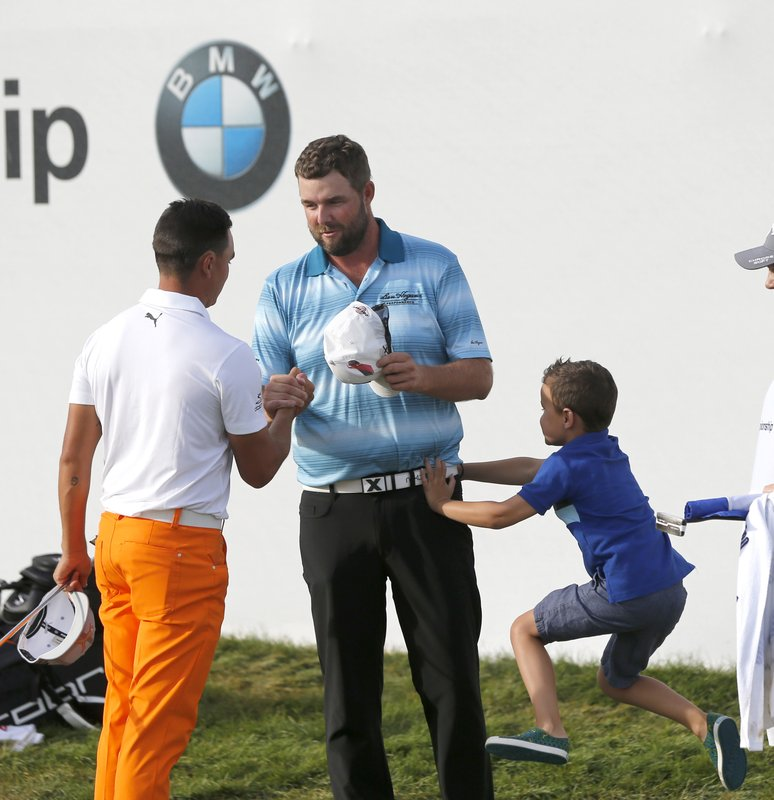 Marc Leishman, Rickie Fowler, Harvey Leishman