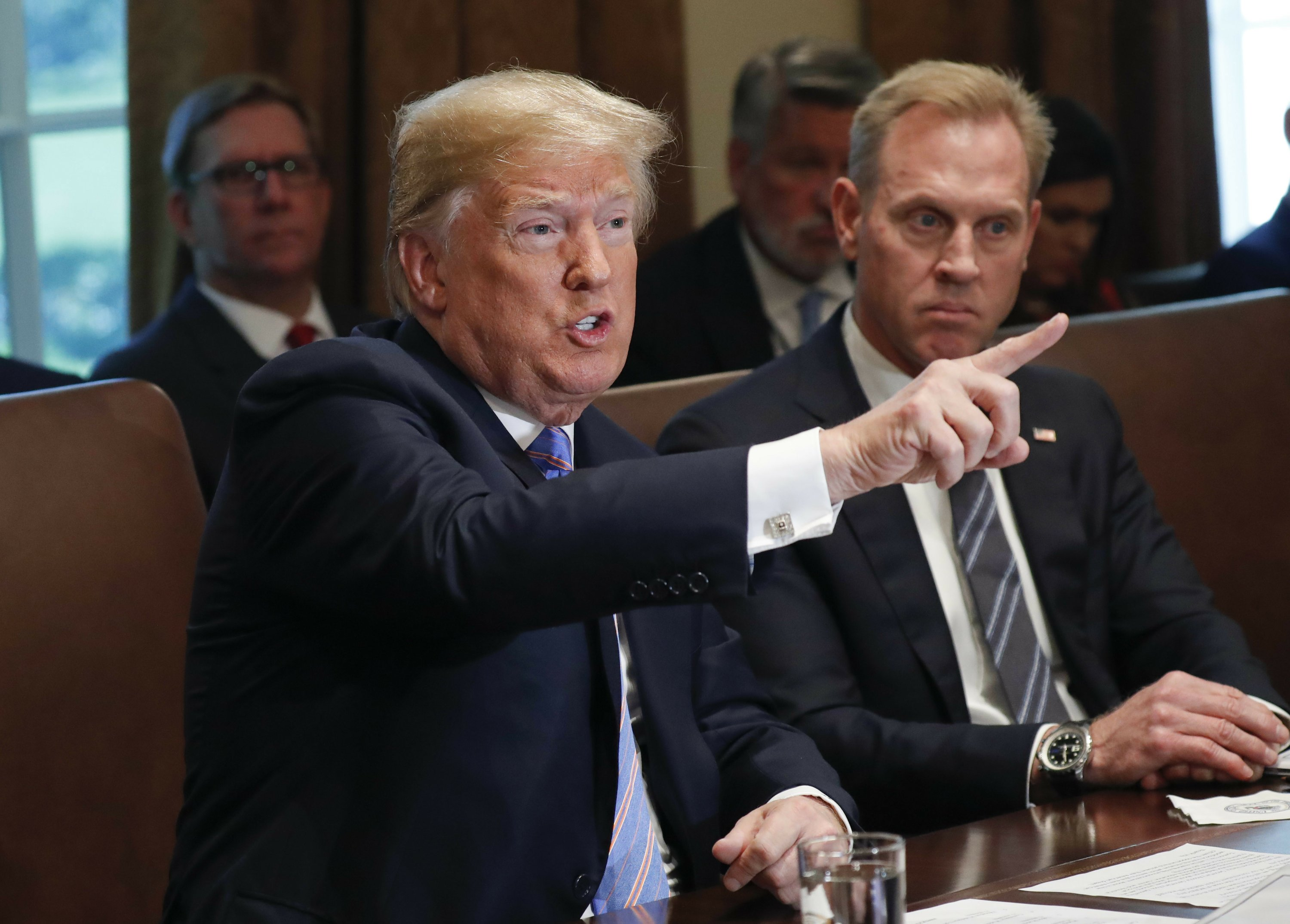 Amid harsh criticism, Trump tries a tougher tone on Russia