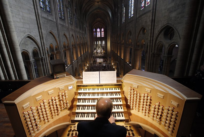 Philippe Lefebvre, 64, plays the organ at Notre Dame cathedral in Paris in May 2013. (Credit: Christophe Ena/AP.)