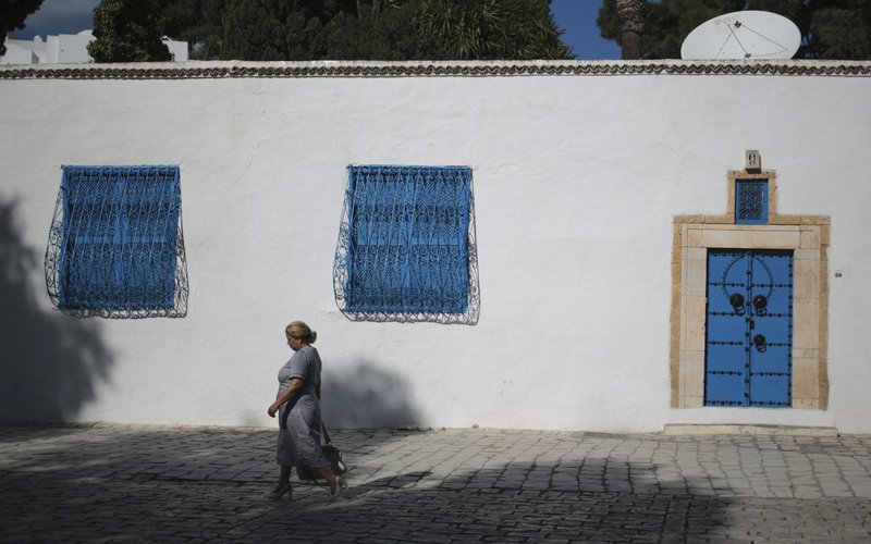 FILE   In This Oct. 24, 2015 Photo, A Woman Walks In The City Of Sidi Bou  Said, North Of Tunis, Tunisia. Some Call It Dangerous, Others Embrace It As  ...