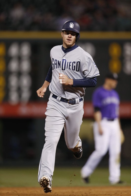 San Diego Padres' Wil Myers circles the bases after a solo home run to lead off the sixth inning off Colorado Rockies starting pitcher Tyler Chatwood in a baseball game Monday, April 10, 2017, in Denver. The Padres won 5-3. (AP Photo/David Zalubowski)