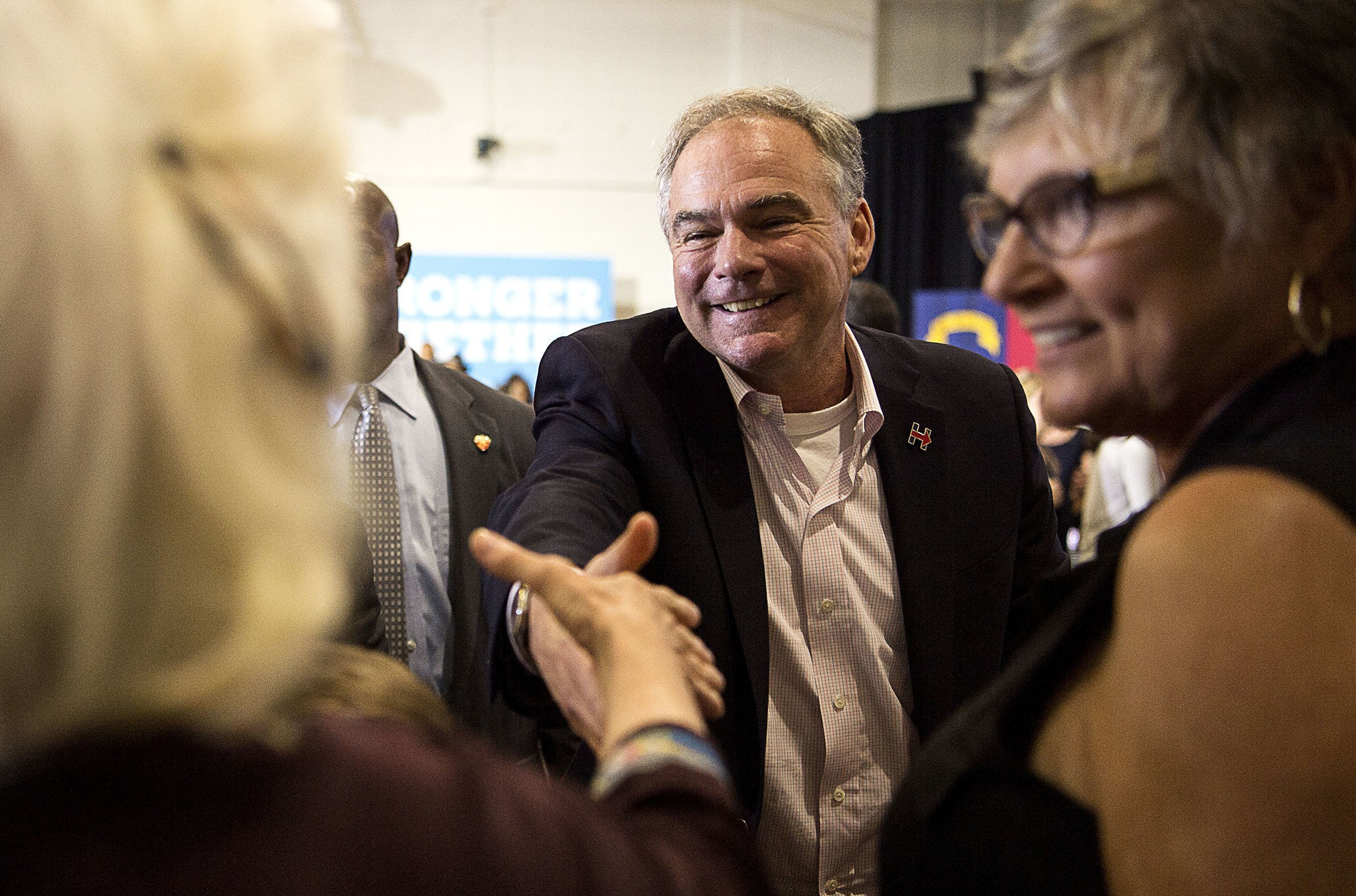The Latest: Tim Kaine wails on harmonica at NC brewery