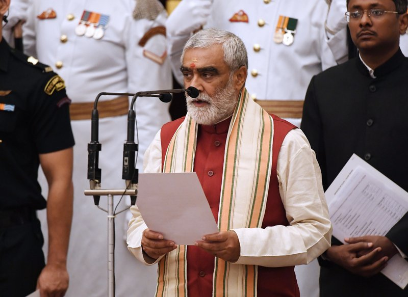 Member of parliament Ashwini Kumar Choubey, takes the oath during the swearing-in ceremony of new ministers at the Presidential Palace in New Delhi, India, Sunday, Sept.3, 2017. India Prime Minister Narendra Modi, on Sunday reshuffled some of his key minister's portfolios to refurbish his government's image, which has been dented by falling economic indicators.