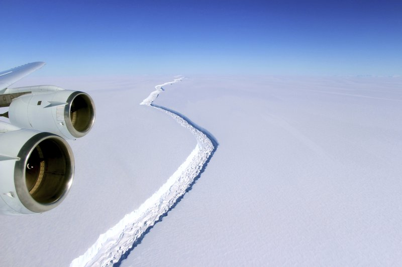 This Nov. 10, 2016 aerial photo released by NASA, shows a rift in the Antarctic Peninsula's Larsen C ice shelf. A vast iceberg with twice the volume of Lake Erie has broken off from a key floating ice shelf in Antarctica, scientists said Wednesday July 12, 2017 . The iceberg broke off from the Larsen C ice shelf, scientists at the University of Swansea in Britain said. The iceberg, which is likely to be named A68, is described as weighing 1 trillion tons (1.12 trillion U.S. tons).