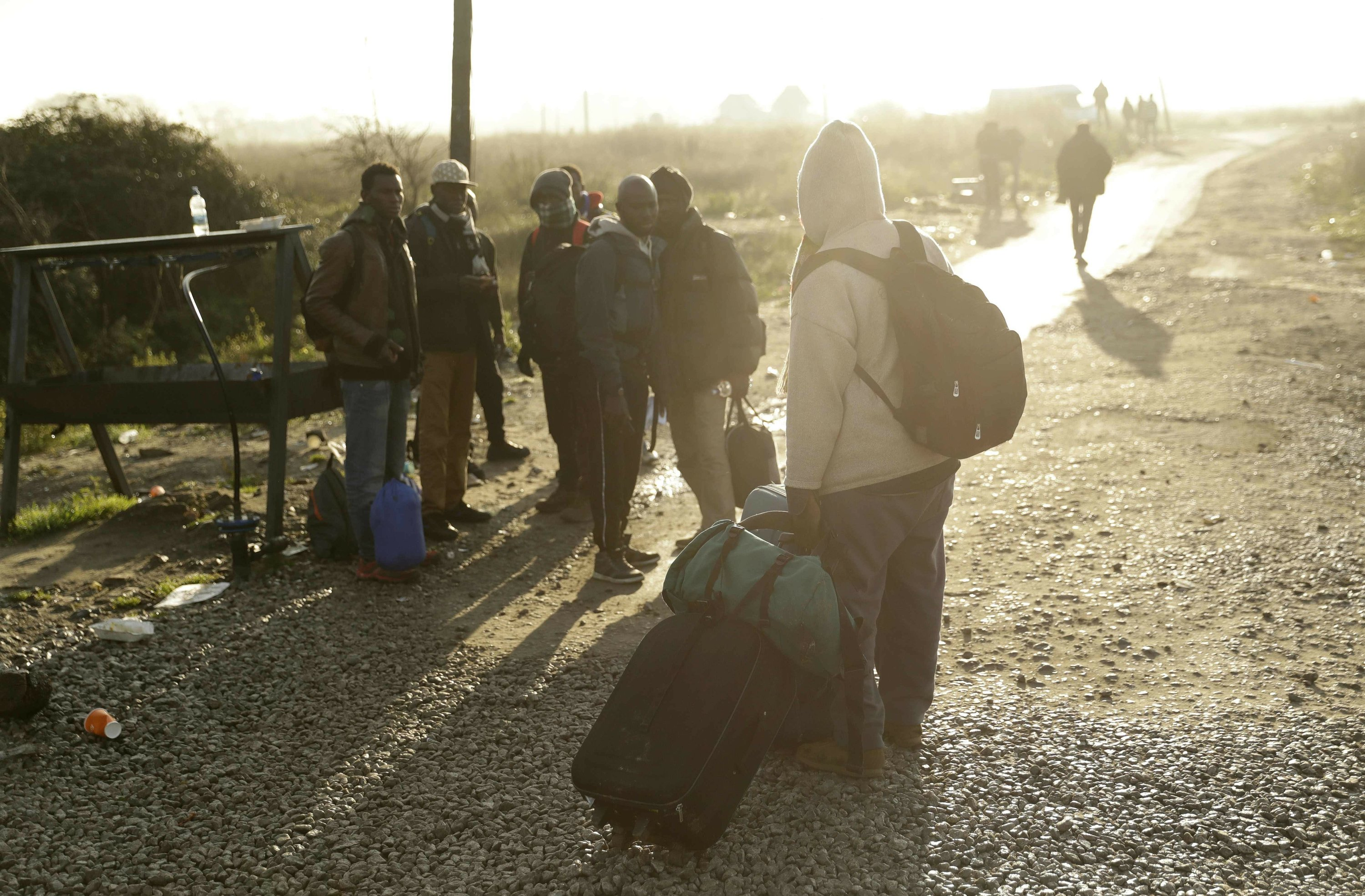 With French camp razed, moved migrants try to adapt again
