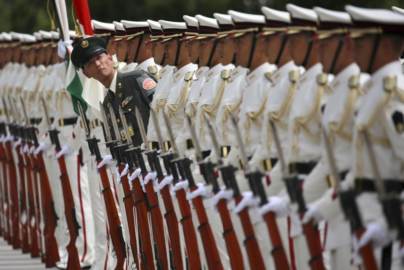 In this Tuesday, Sept. 5, 2017, file photo, Japanese honor guard members prepare for inspection by Indian Defense Minister Arun Jaitley at the Defense Ministry in Tokyo.
