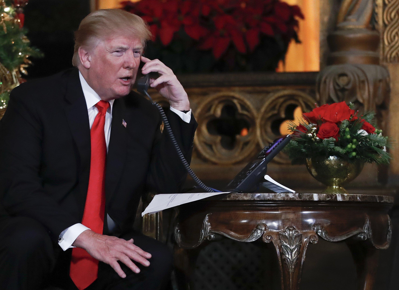 The Latest: Trump says tax cuts will make 2018 'great year'