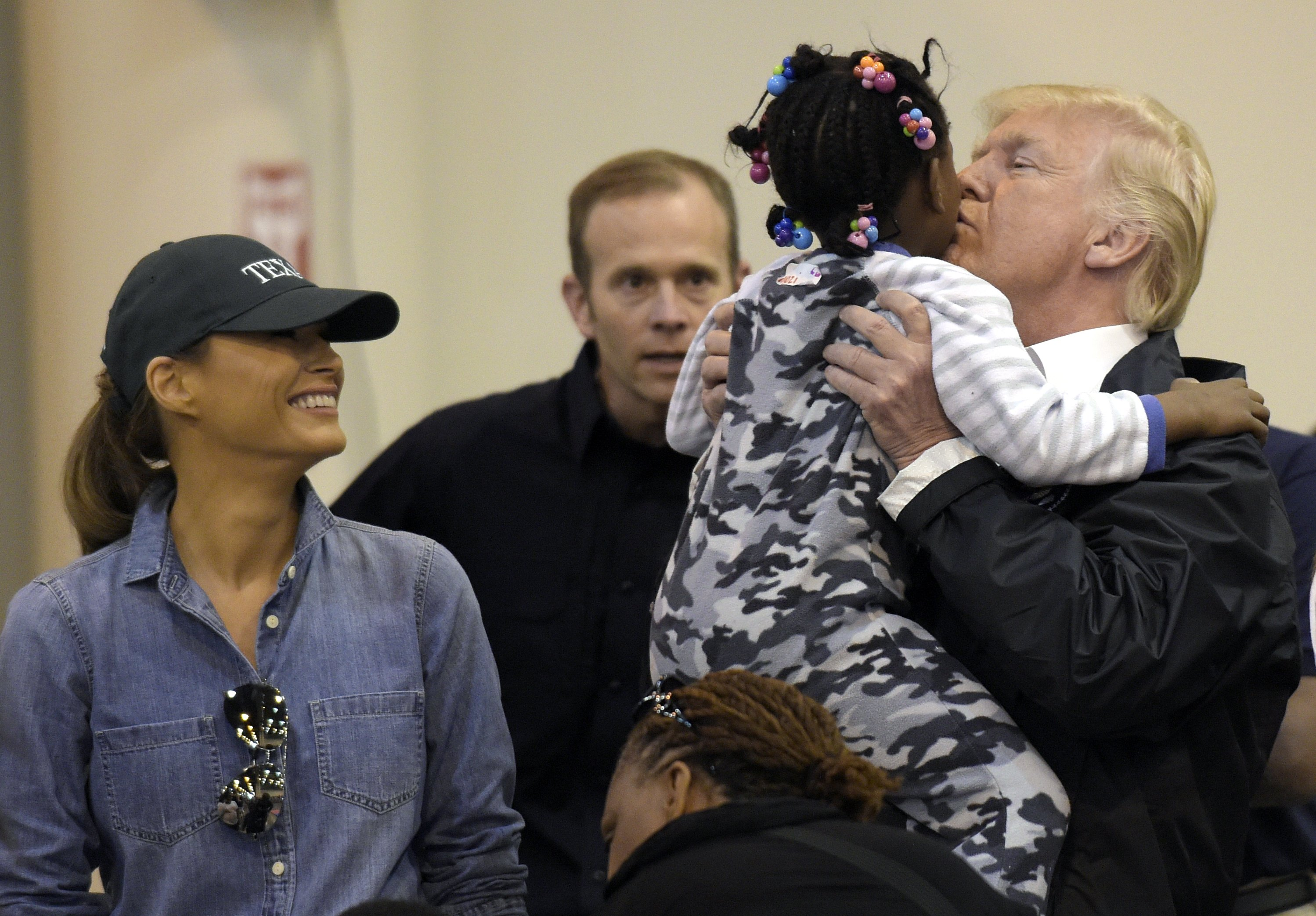 Trump pitches in at shelter for Harvey victims