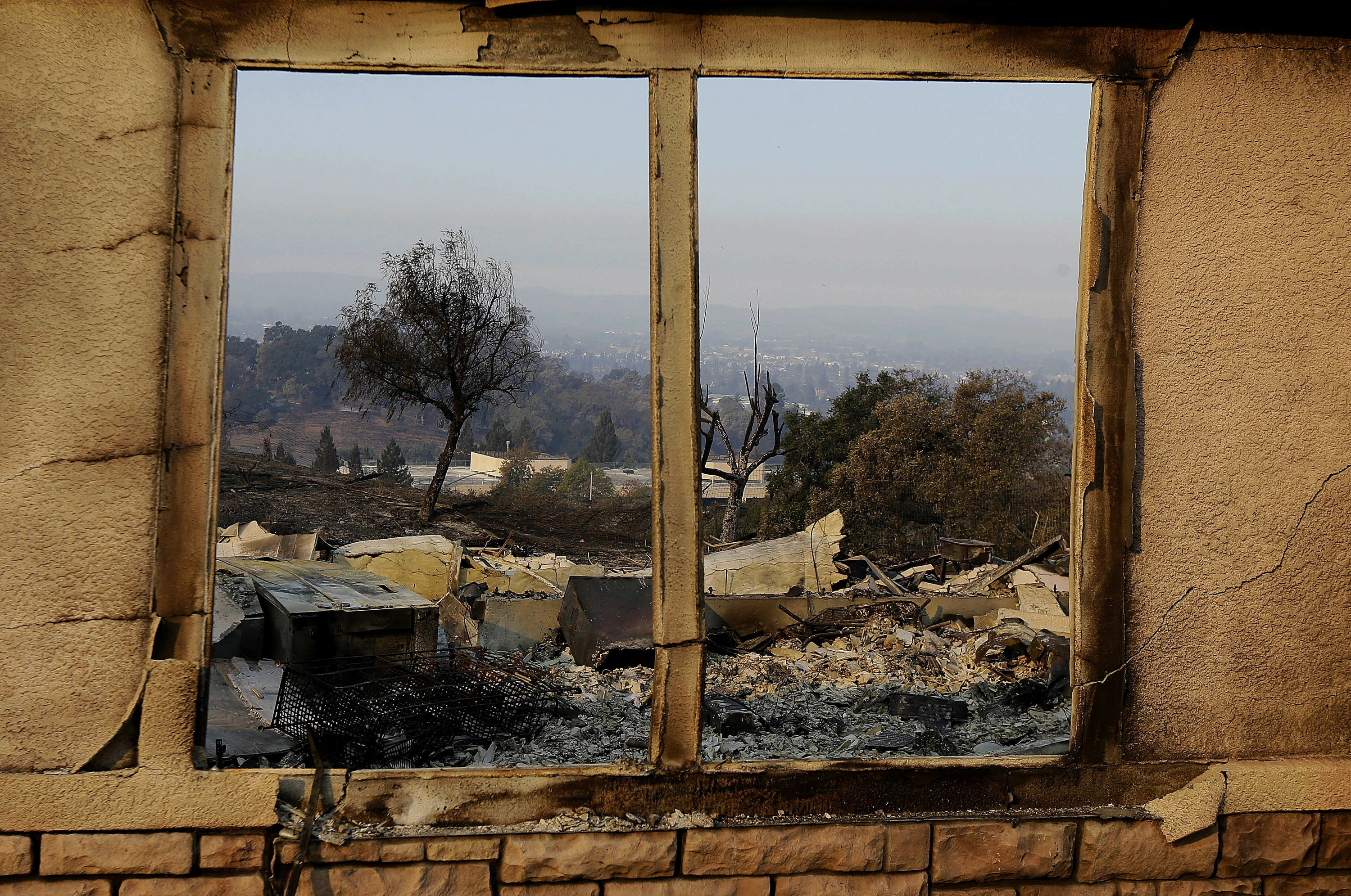 Searchers look for bodies in California's charred ruins