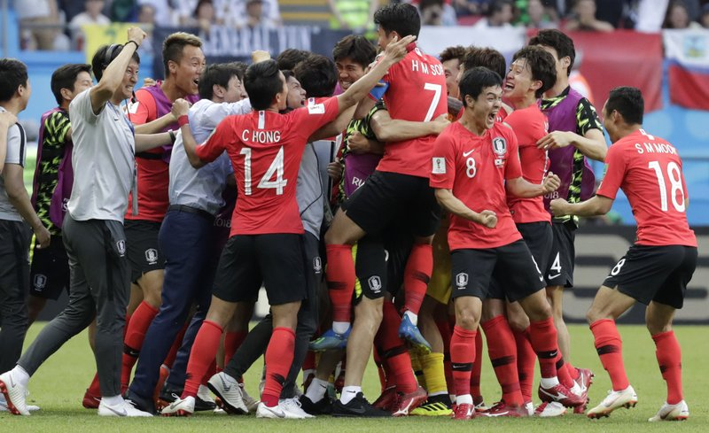 South Korea's players celebrate a goal during the group F match between South Korea and Germany, at the 2018 soccer World Cup in the Kazan Arena in Kazan, Russia, Wednesday, June 27, 2018.