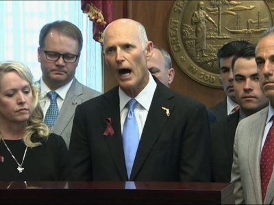 Gov. Scott Signs Compromise Gun Control Bill