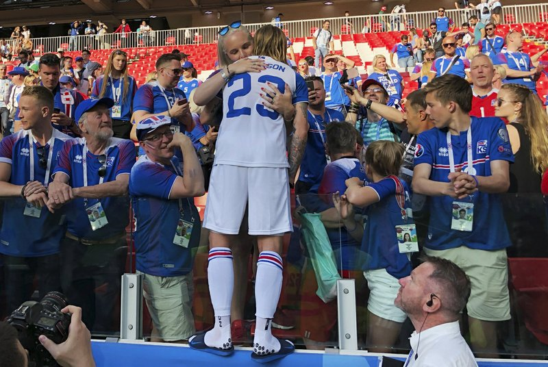 Iceland's Ari Skulason hugs a woman after a draw during the group D match between Argentina and Iceland at the 2018 soccer World Cup in the Spartak Stadium in Moscow, Russia, Saturday, June 16, 2018.
