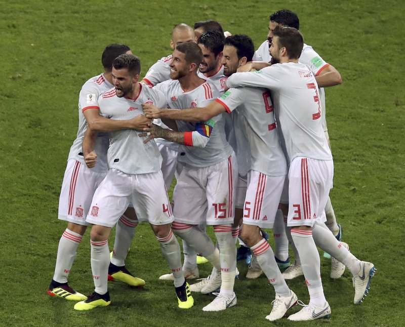 Spain's scorer Nacho, front left, and his teammates celebrate their side's 3rd goal during the group B match between Portugal and Spain at the 2018 soccer World Cup in the Fisht Stadium in Sochi, Russia, Friday, June 15, 2018.