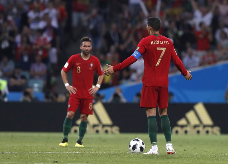 Portugal's Cristiano Ronaldo gestures to his teammates after Spain scored their 3rd goal during the group B match between Portugal and Spain at the 2018 soccer World Cup in the Fisht Stadium in Sochi, Russia, Friday, June 15, 2018.