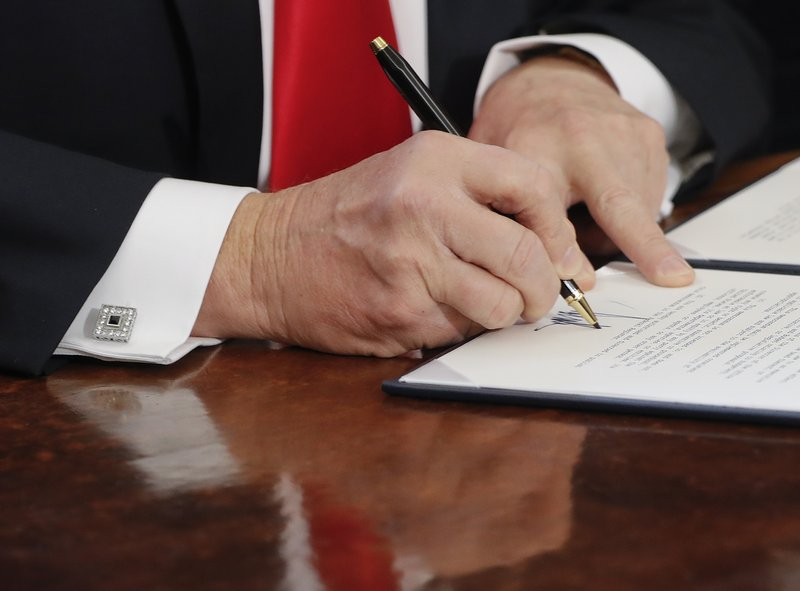 Trump, fond of executive orders, awaits more fancy pens