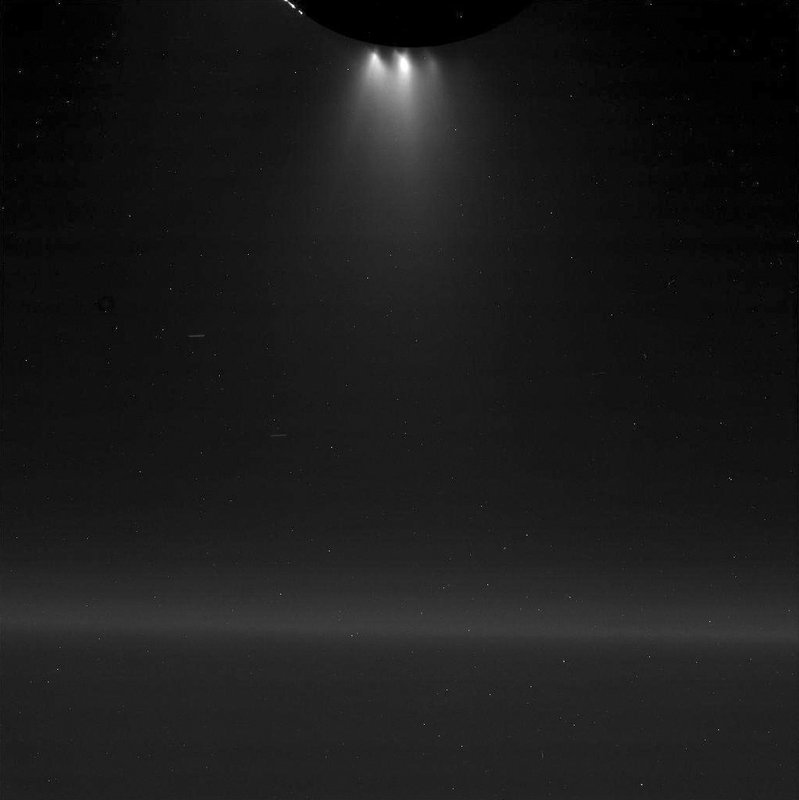 This Wednesday, Oct. 28, 2015 image provided by NASA shows plumes of gas and dust-sized icy particles, top, emerging from the southern region of Saturn's moon Enceladus as the Cassini spacecraft made a close flyby of the icy moon. NASA's Cassini spacecraft has detected hydrogen molecules in the geysers shooting off the ice-encrusted ocean world, possibly the result of deep-sea chemical reactions between water and rock that could spark microbial life, according to findings announced Thursday, April 13, 2017 in the journal Science.