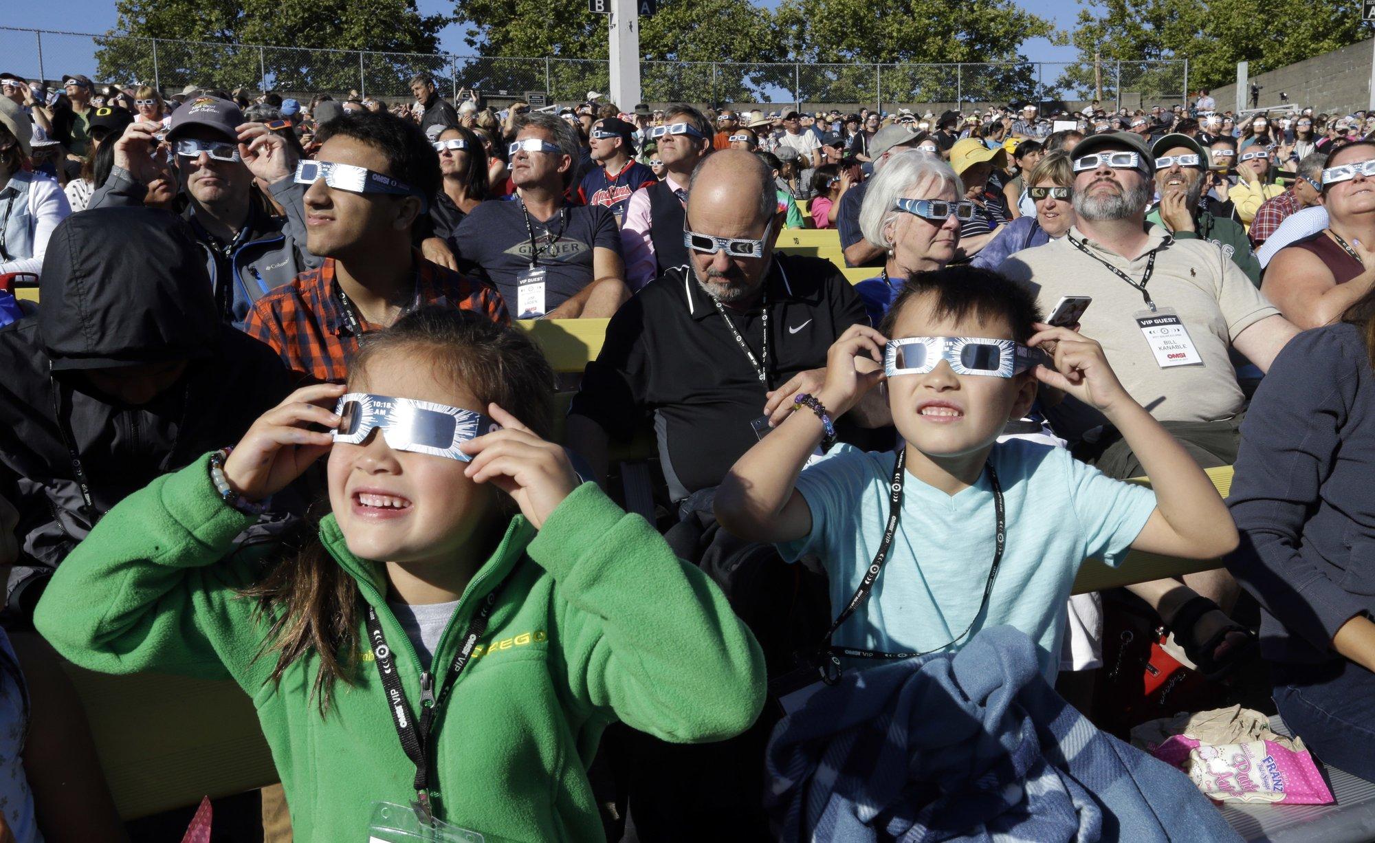 The Latest: Car strikes 2 women watching eclipse, 1 dies