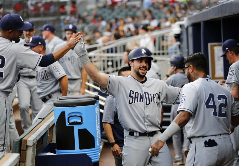 San Diego Padres' Austin Hedges (18) celebrates after hitting a two-run home run in the second inning of a baseball game against the Atlanta Braves, Saturday, April 15, 2017, in Atlanta. (AP Photo/John Bazemore)