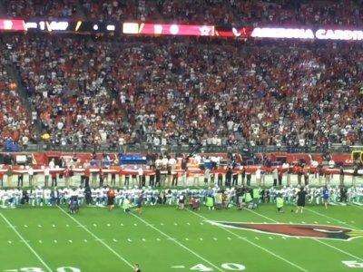 Arizona Crowd Boos as Dallas Cowboys Kneel