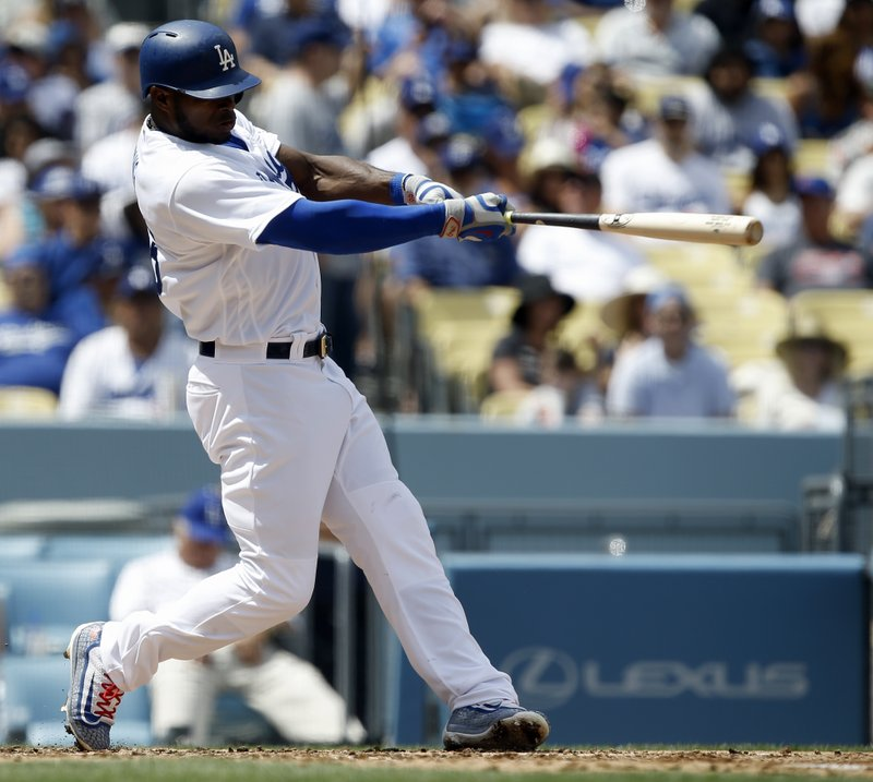 Los Angeles' Yasiel Puig hits his second two-run home run of the game, against the San Diego Padres during the fourth inning of a baseball game in Los Angeles, Thursday, April 6, 2017. (AP Photo/Alex Gallardo)