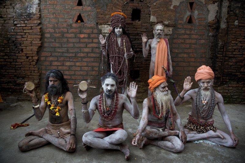 Indian Hindu holy men strike yogic poses on International Yoga Day at the Kamakhya temple in Gauhati, India, Thursday, June 21, 2018. Yoga enthusiasts across the world Thursday took part in mass yoga events to mark International Yoga Day.