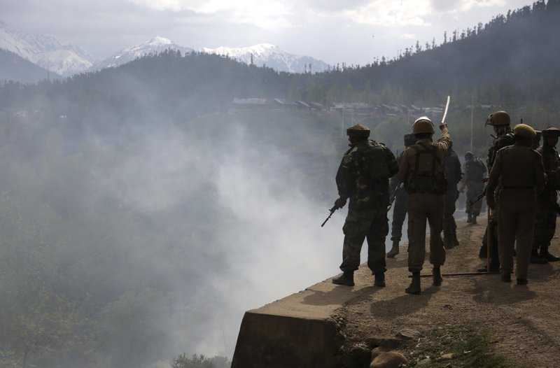 Indian army soldiers and police clash with Kashmiri villagers who were demanding the bodies of militants killed in a gun battle after a group of militants stormed a military camp in Panzgam, 127 Kilometers (79 miles) northwest of Srinagar, Indian controlled Kashmir, on Thursday, April 27, 2017. A 70-year-old civilian was killed and seven people were injured during an anti-India protest that erupted Thursday following a gun-battle that killed three Indian soldiers and two suspected rebels in disputed Kashmir, police said.