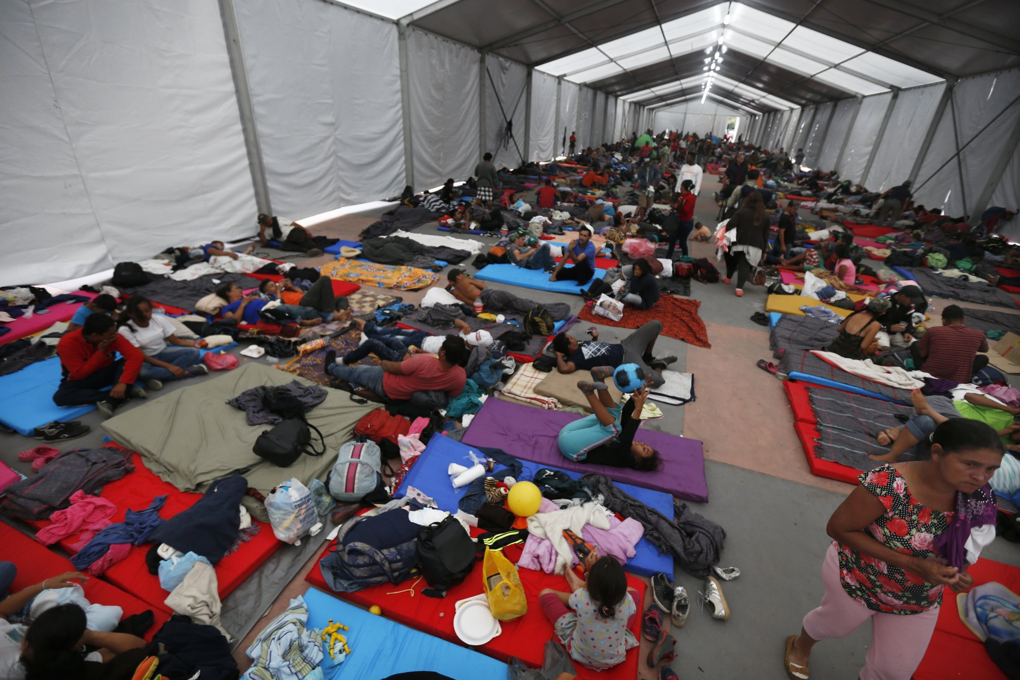 Migrants straggle into Mexico City to shelter at stadium