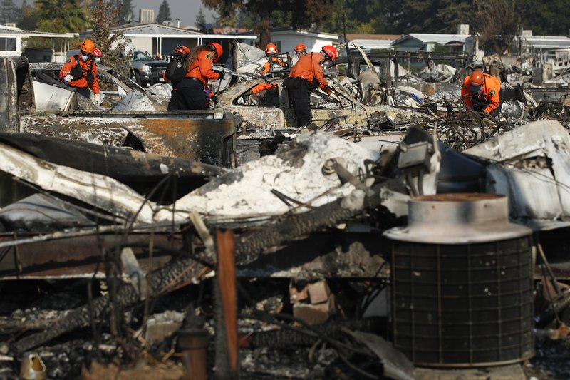 Members Of A Search And Rescue Team Through The Rubble Mobile Homes Destroyed By Wildfire Monday Oct 16 2017 In Santa Rosa Calif