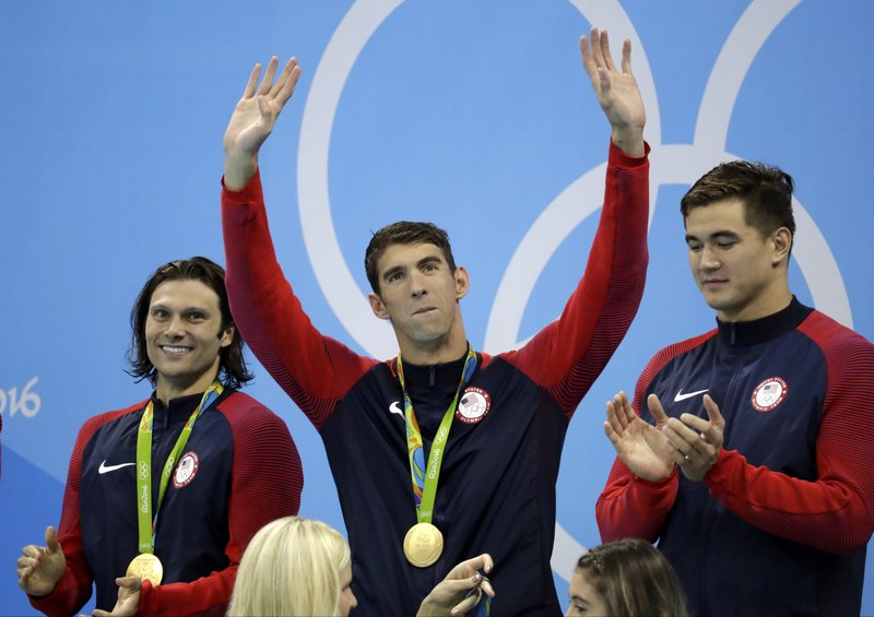 The Latest: Phelps insists gold medal No. 23 is his last