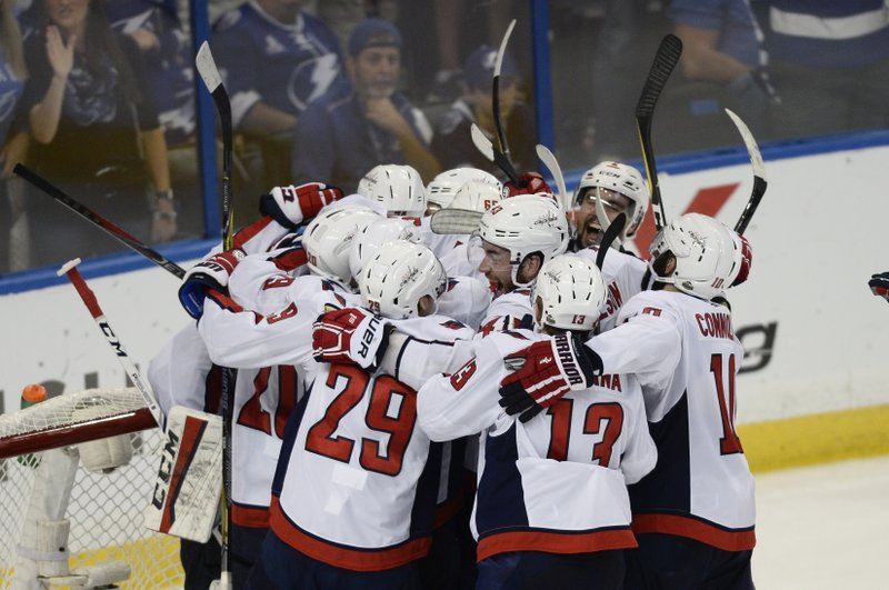 Washington Capitals celebrate after defeating the Tampa Bay Lightning 4-0  in Game 7 of the NHL Eastern Conference finals hockey playoff series  Wednesday 1c8bf439eb74