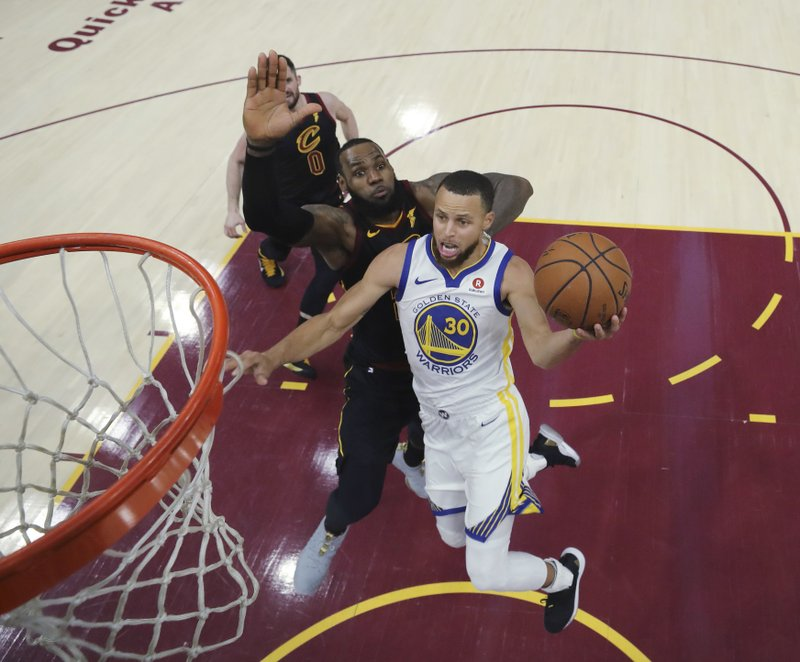 Golden State Warriors  Stephen Curry shoots next to Cleveland Cavaliers  LeBron  James during the second half of Game 3 of basketball s NBA Finals 3246abbc1
