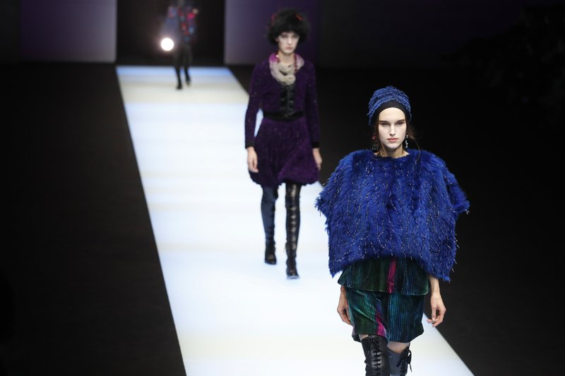 7074e5d9bfa Models wear creations as part of the Armani women s Fall Winter 2018-2019  collection