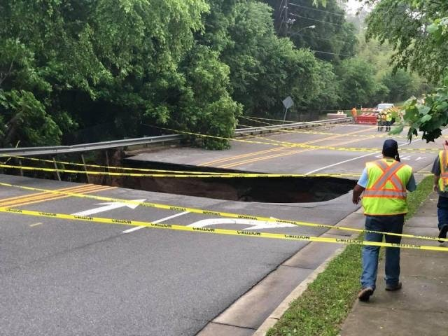 Heavy rain on Monday evening created a 25-feet-deep sinkhole in Raleigh, leaving some roads impassable.