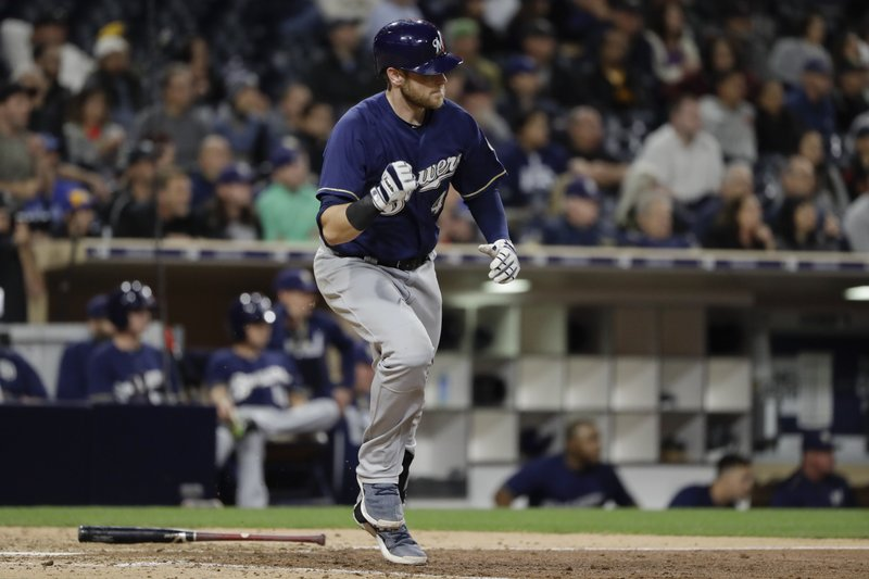 Milwaukee Brewers' Jett Bandy reacts as he watches his RBI single during the ninth inning of a baseball game against the San Diego Padres on Wednesday, May 17, 2017, in San Diego. (AP Photo/Gregory Bull)