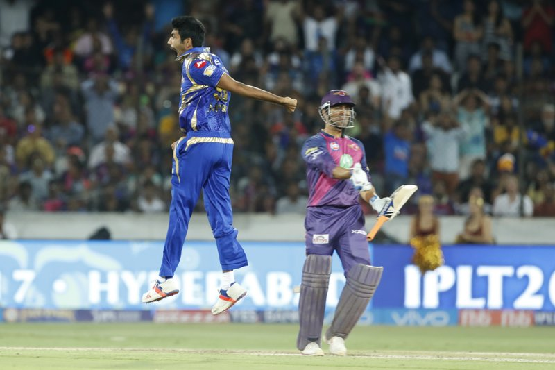 Mumbai Indians' Jasprit Bumra, left, celebrates the dismissal of Rising Pune Supergiant's Mahendra Singh Dhoni during their Indian Premier League (IPL) cricket final match in Hyderabad, India, Sunday, May 21, 2017.