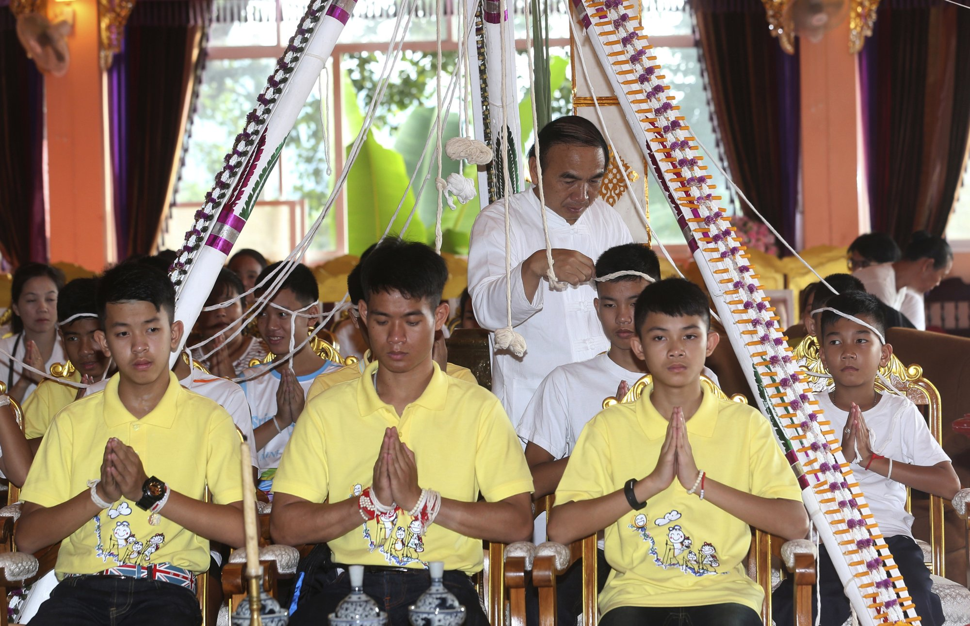After rescue, soccer boys pray for protection at Thai temple