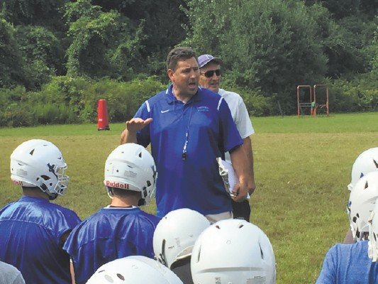 High School Football Teams Get to Work