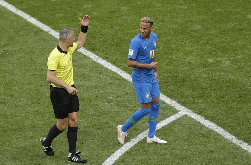 Brazil's Neymar, right, looks at referee Bjorn Kuipers from Netherlands during the group E match between Brazil and Costa Rica at the 2018 soccer World Cup in the St. Petersburg Stadium in St. Petersburg, Russia, Friday, June 22, 2018.
